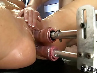 Chick in scrubs her pink bottom with her sapphic double machine
