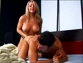 Blonde with great sexy body plays with strapons on stage