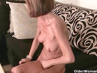 woman with nice tits is massaging her pussy lovingly