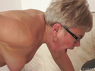 Busty english granny deep throats another cock