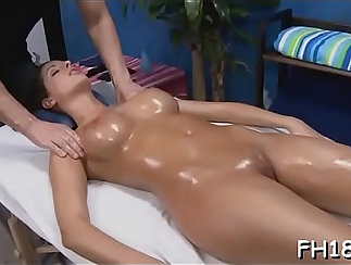 Blonde gets massaged and covers her naked body with semen